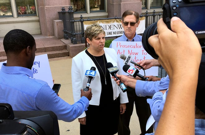 Attorney Nicole Gorovsky speaks to reporters in St. Louis on Wednesday, Aug. 22, 2018, with clergy sex abuse advocate and victim David Clohessy by her side. Gorovsky, Clohessy and Mary Ellen Kruger spoke outside the St. Louis office of Attorney General Josh Hawley, calling for a wide-scale investigation of sex abuse by priests in Missouri.