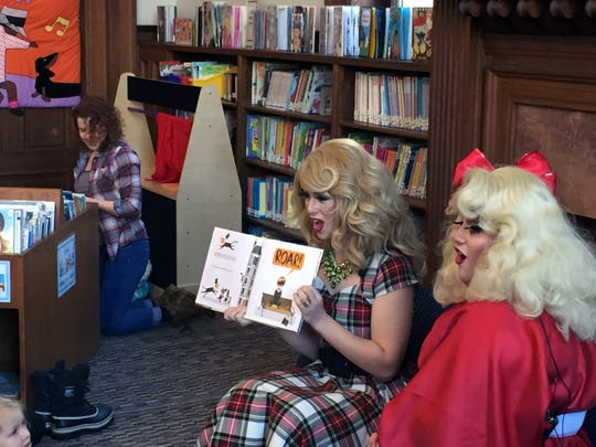 """Burlington, Vermont: Nikki Champagne and Emoji Nightmare encourage kids to roar Dec. 16, 2017, while reading """"Mr. Tiger Goes Wild"""" during Drag Queen Story Hour at Fletcher Free Library."""