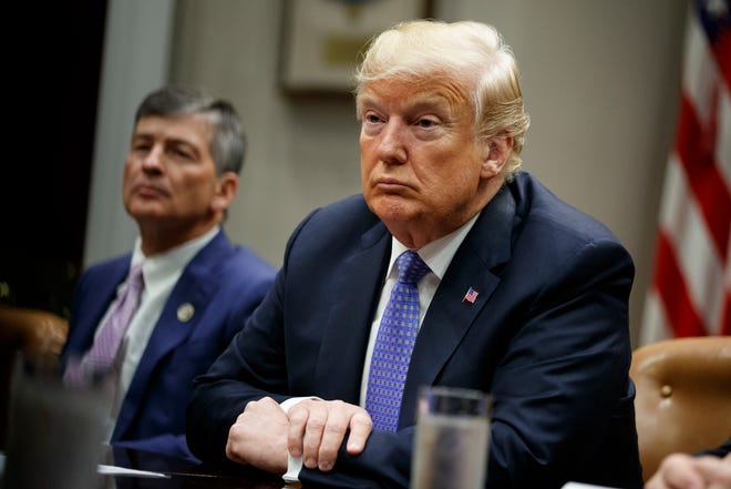 """Rep. Jeb Hensarling, R- Texas, left, and President Donald Trump listen during a roundtable on the """"Foreign Investment Risk Review Modernization Act"""" in the Roosevelt Room of the White House on Aug. 23, 2018, in Washington."""