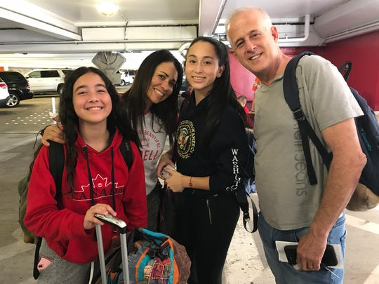 Personal trainer Carla Magallanes and her family at the Honolulu airport. They had come to take part in the grueling Spartan obstacle race, but it had been cancelled as they flew to Hawaii from their home in Florida, due to the possible arrival of Hurricane Lane.