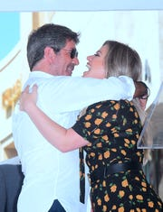 Simon Cowell and Kelly Clarkson share a hug at his Hollywood Walk of Fame Star ceremony in Hollywood, California, on August 22, 2018.