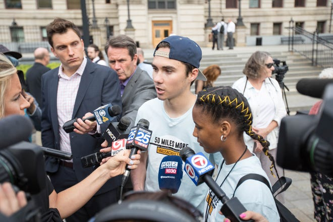 David Hogg speaks before the kickoff of the 50 Miles More walk against gun violence  Aug. 23, 2018, in Worcester, Mass.