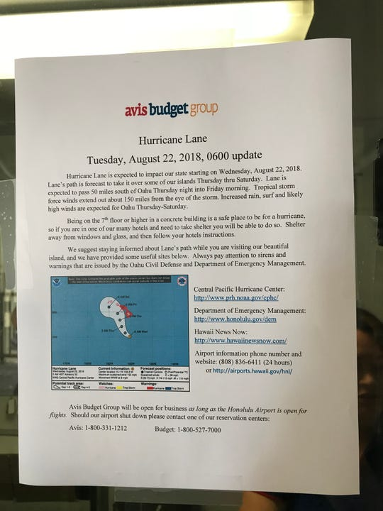 A sign at the Budget rental car pickup at the Honolulu airport warning travelers of the possible arrival of Hurricane Lane.