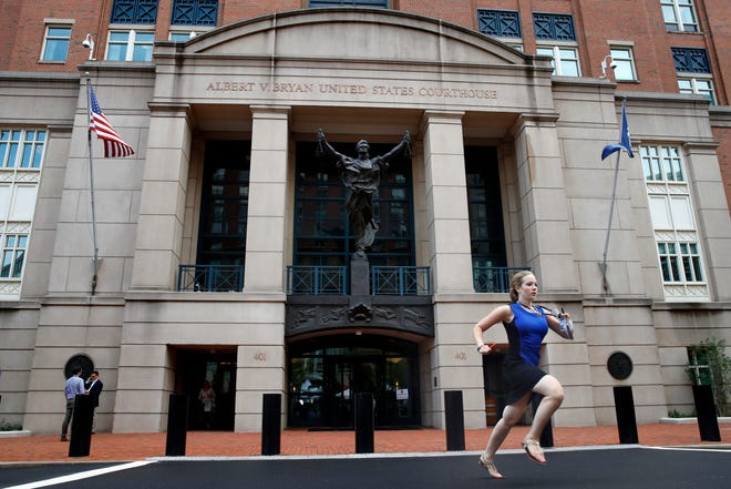 Cassie Semyon, 21, an intern for NBC News, runs from the courthouse with results outside of federal court as jury deliberations are announced in the trial of the former Donald Trump campaign chairman Paul Manafort.