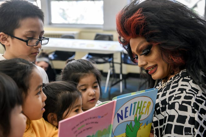 South Salem, New York: Angel Velasquez of Yonkers, New York, reads to children as drag queen persona Angel Elektra. Velasquez read July 14, 2018, to participants of Drag Queen Story Hour at the Lewisboro Library.