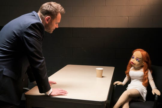 """Joel McHale's Agent Campbell interviews the Sharon Stone-like suspect Sandra in """"The Happytime Murders."""""""