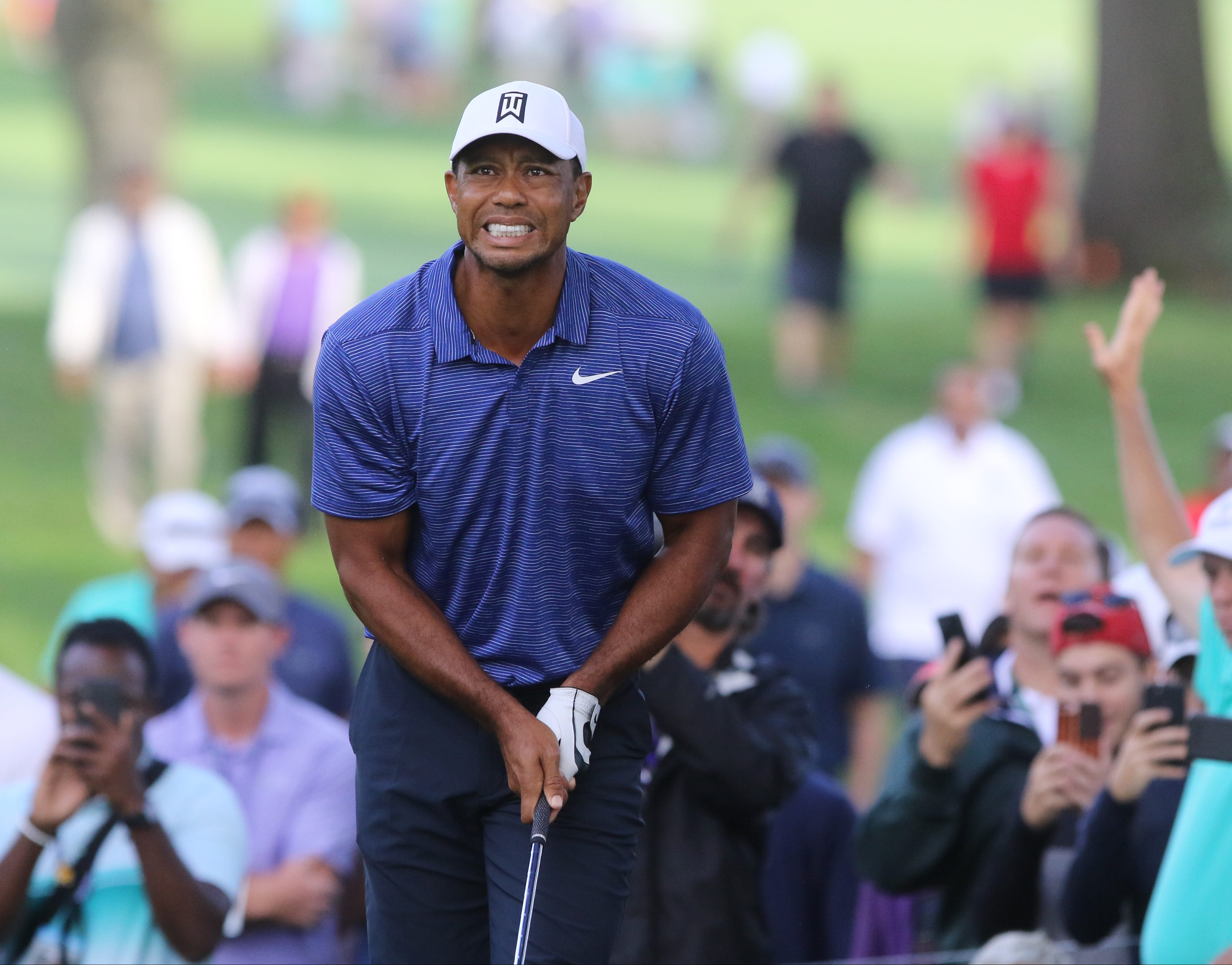 tiger woods stuck in neutral  goes on defensive at