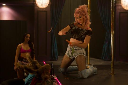 "Exotic dancer Jenny (Elizabeth Banks) entertains her rabbit clientele in ""The Happytime Murders."""