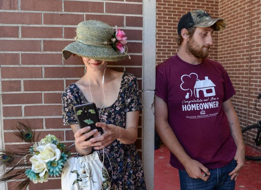 Homeless at the Salvation Army shelter in Anderson, Kelsey Woodring, left, borrows a phone to spend time video calling her grandmother, while her friend Dylan Hampton of Anderson stands nearby. Woodring said one of the best things she did was leave her home county in Oconee to recover from her drug addiction. Hampton said the Salvation Army has been very helpful getting his life back.
