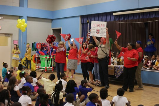 Mabel Brasher Montessori sorted students by color during a kickoff ceremony Friday for the elementary school's new house system. The program is intended to encourage good behavior, character-building and collaboration. The school's faculty and staff were sorted into houses earlier this year.