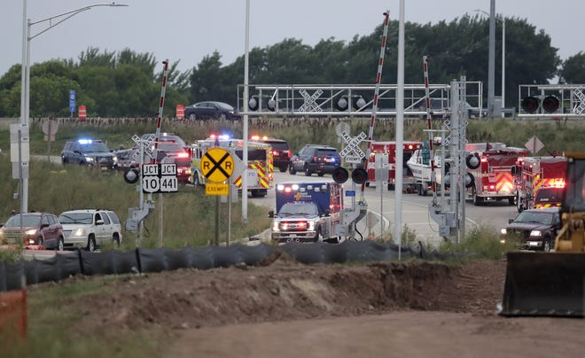 An ambulance leaves the scene of a crash on the U.S. 10/State 441 exit ramp at Racine Street in Fox Crossing.