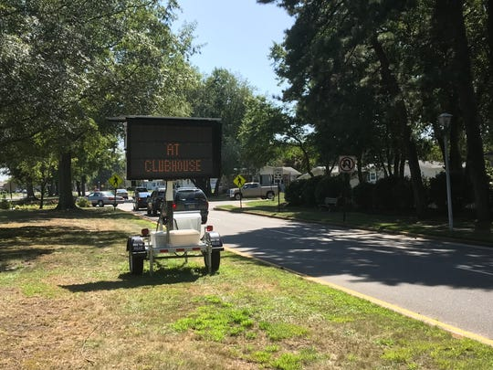 A message board instructs contractors to check in at the clubhouse inside the Greenbriar retirement community in Brick, where flash flooding damaged the homes of 200 residents on August 13.