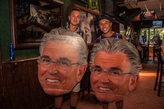Crowds gather to drink and watch the Mike Francesa Show live at Bar Anticipation.