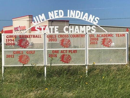 Entering Tuscola from the north, a sign shows off the Jim Ned Consolidated Independent School District's recent prowess in University Interscholastic League competition.