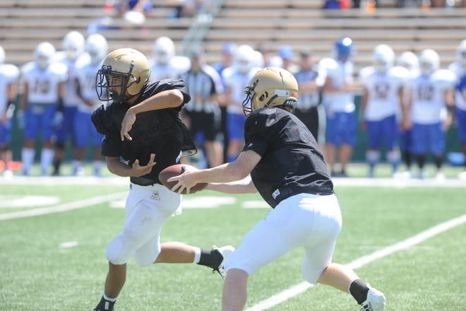 Eric Abbe fakes a handoff during Abilene High's scrimmage Aug. 24 against Copperas Cove. Abbe was competing for the starting quarterback's job to replace graduated Andrew Ezell.