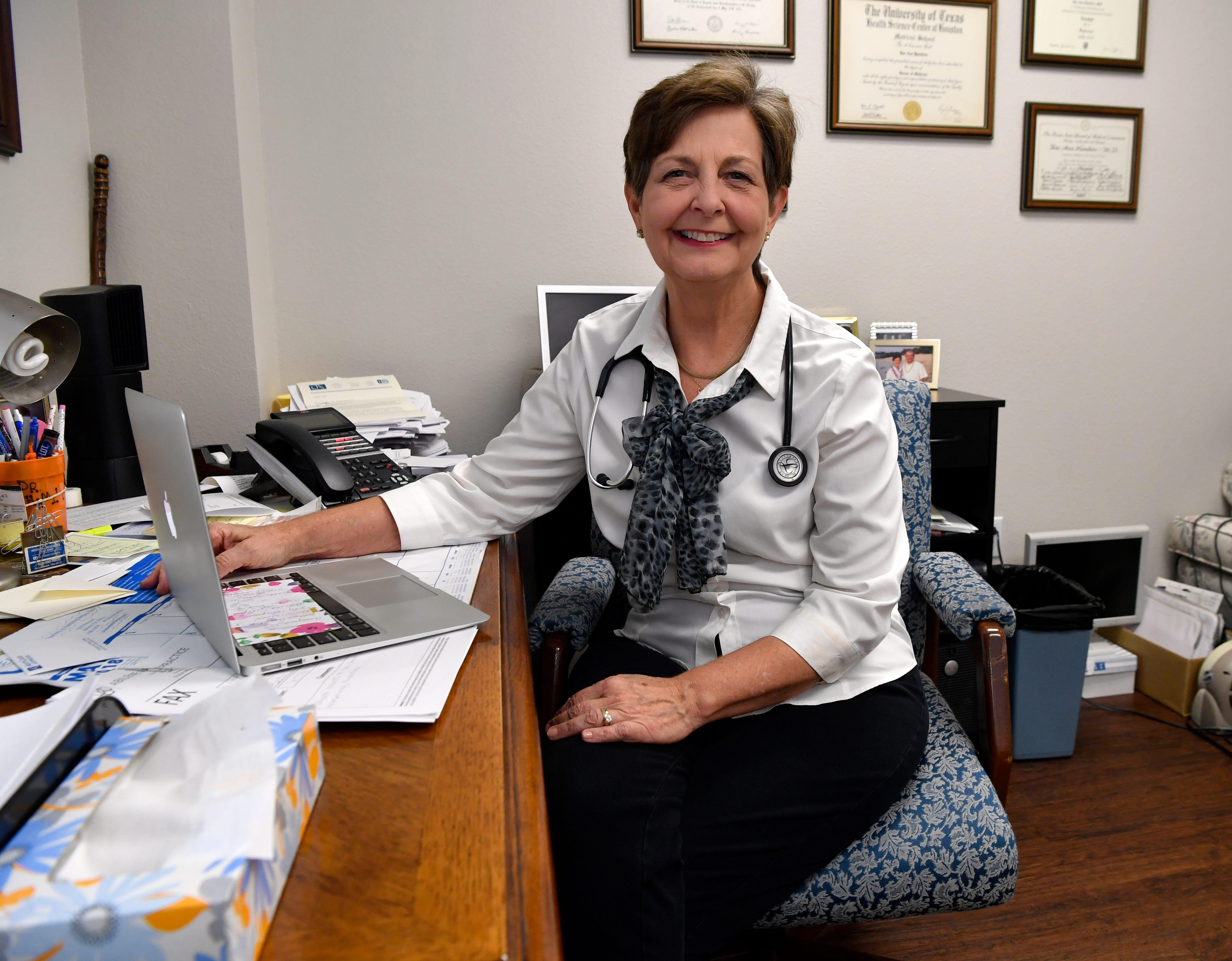 Dr. Rae Ann Hamilton in her office.