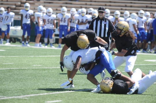 A trio of Eagles tackle a Copperas Cove receiver during Abilene High's scrimmage earlier this month. AHS opens the season Friday at Amarillo Tascosa.