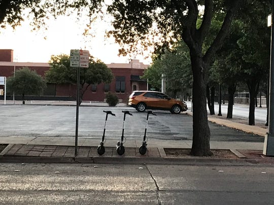 Bird electric scooters were parked in downtown Abilene on Friday, Aug. 24, 2018.
