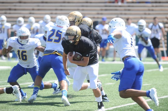 Esai Jaques sprints through a hole in the Copperas Cove defense during Abilene High's scrimmage Friday, Aug. 24, 2018.