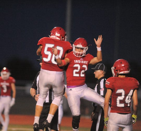 Jim Ned running back Cooper Castro (22) celebrates with an offensive lineman after a touchdown in a scrimmage against Stamford at Indian Stadium on Aug. 23, 2018.