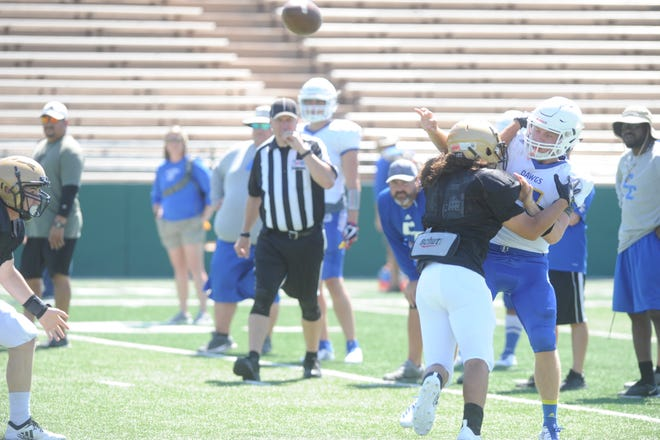 Jorge Hernandez tackles a Copperas Cove Quarterback during Abilene High's scrimmage Friday, Aug. 24, 2018.
