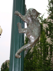 Vadim Bora's bronze sculpture of a cat, which was attached to a light pole on Wall Street, apparently has been stolen.