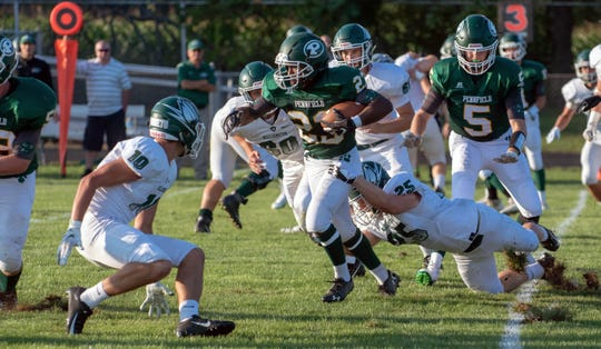 Pennfield running back Markus Roberts (23) finds a crease and rushes for positive yards during first quarter of play Thursday night.