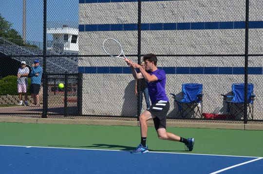 Cole Einhardt plays at No. 3 singles during the All-City tennis tourney on Thursday.