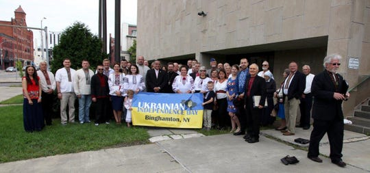 Members of the local Ukranian community celebrated Ukranian Indepence Day with a flag raising at Binghamton City Hall Thursday.