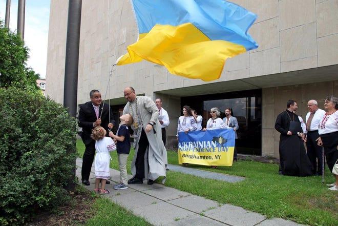 Binghamton Mayor Richard David joined members of the local Ukrainian community to raise a Ukrainian flag at Binghamton City Hall Thursday.