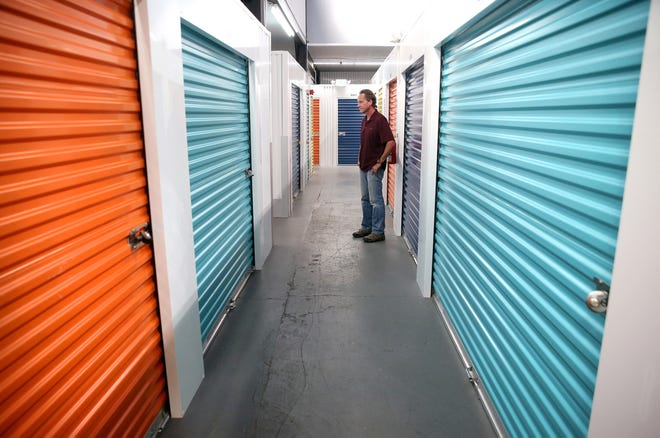 "Owner Paul "" Trip"" McConkey at his Penn Plaza storage unit in Bremerton. Demand far exceeds supply for storage in the city, and many owners have long waiting lists."