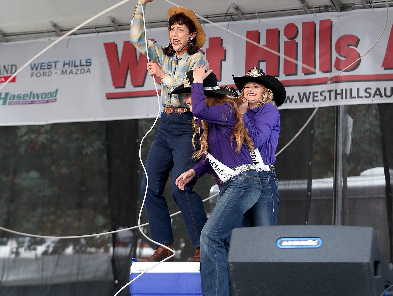 Karen Quest ropes cowgirl royalty in her cowgirl tricks show at the Kitsap County Fair & Stampede on Friday, August 24, 2018 at the Kitsap County Fairgrounds.