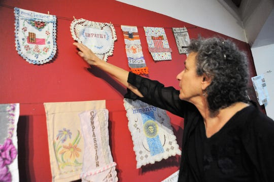 "A prayer flag created by Jean Tomaso Moore featuring the word ""empathy"" on a piece of lace fabric is one of 100 she made over the course of 100 days."