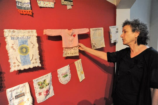 """Black Mountain's Jean Tomaso Moore talks about the inspiration behind a prayer flag that she made out of an old children's sweater. The flag, one of 100 she created in as many days, contains the word """"tolerance."""""""