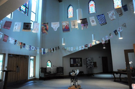 Jean Tomaso Moore's prayer flags displayed in the narthex at St. James Episcopal Church in Black Mountain.