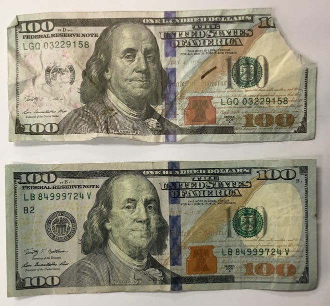 The Crawford County Sheriff's office reported that more counterfeit bills have been found in the county. Pictured is a fake $100 bill (top), with a real $100 bill (bottom).