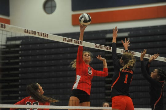 Pleasant's Laina Sansotta tips one over the net against Galion.