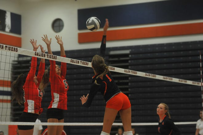 Galion's Samantha Comer hits across the net toward Pleasant's Laina Sansotta and Carlie Craycraft.