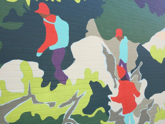Some of the images of Jess Graham's work-in-progress mural on Cherry Street in Burlington.