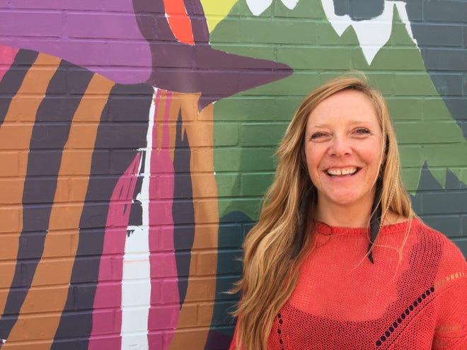 Morrisville artist Jess Graham is creating a 3,000-square-foot mural on Cherry Street on the side of Outdoor Gear Exchange.