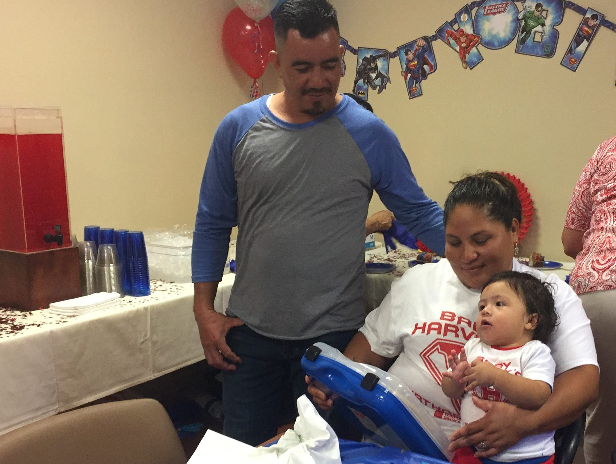 One-year-old Harvey Cantarero, with his parents, Irma Rodriguez and Marcos Antonio Cantarero.