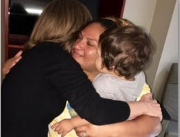 Irma Rodriguez and her son, Harvey Cantarero, see the doctor who delivered Harvey for the first time since the storm.