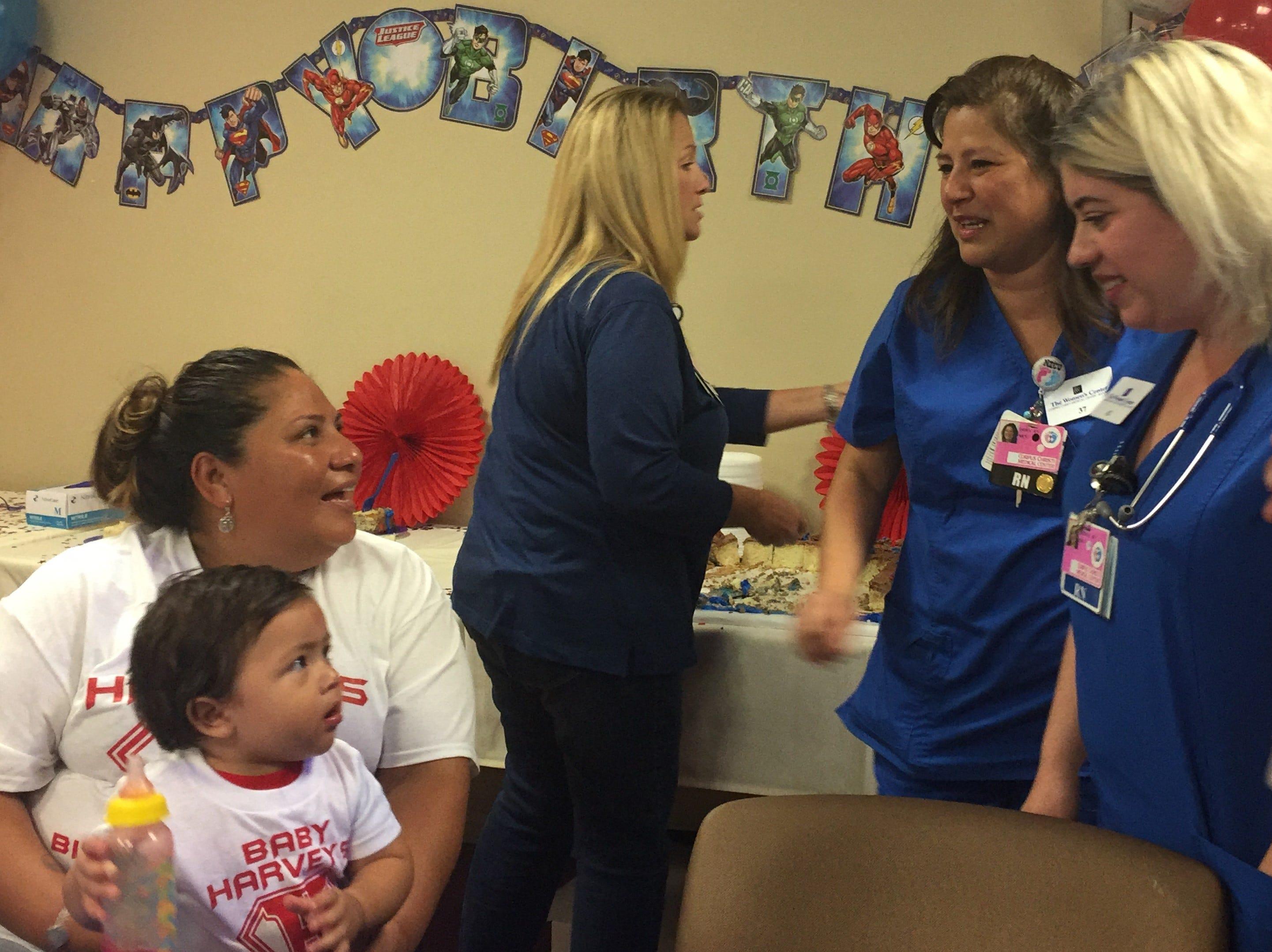 Irma Rodriguez holds her son Harvey as she talks to NICU nurses Dora Flores (left) and Jessica Mechaca.