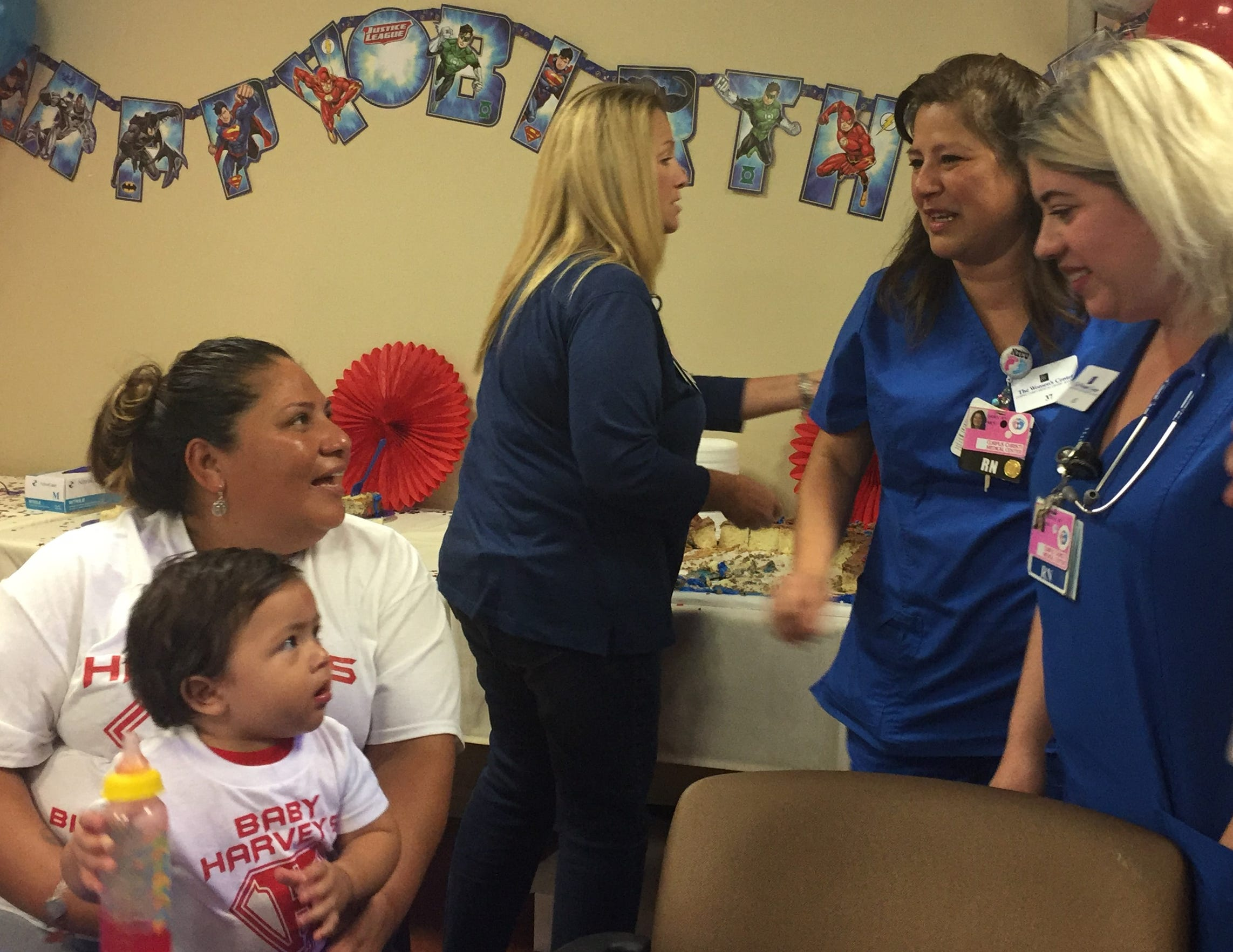 Irma Rodriguez holds her son Harvey as she talks to NICU nurses Dora Flores (left) and Jessica Mechaca.