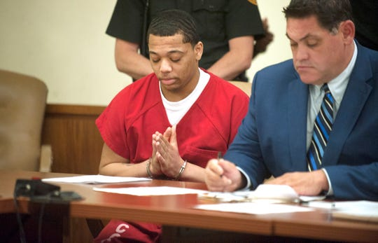 Tyhan Brown, who was convicted of fatally shooting 8-year-old Gabby Hill-Carter as she played outside her city home in August 2016, sits next to defense attorney Adam Brent prior to being sentenced to up to 51 years in state prison Friday, August 24, 2018, at the Camden County Hall of Justice.