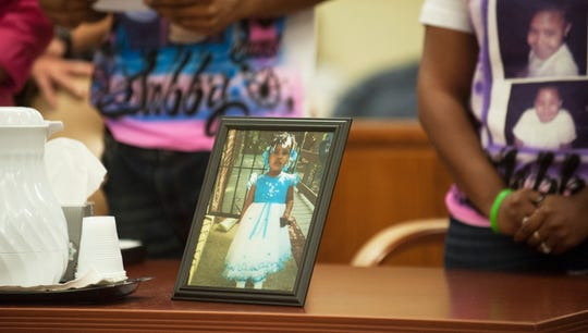 A photograph of Gabby Hill-Carter is displayed during the sentencing of Tyhan Brown, who was convicted of fatally shooting 8-year-old Hill-Carter as she played outside her Camden home in August 2016.  Brown was sentenced to up to 51 years in state prison Friday, August 24, 2018, at the Camden County Hall of Justice.