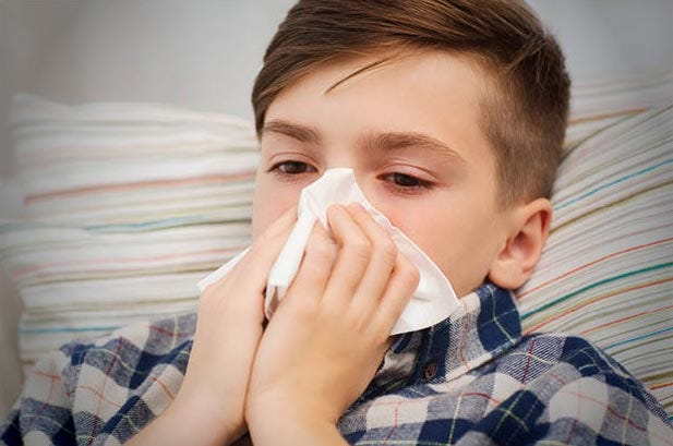 Keep children at home if their fever is above 100.4 degrees.