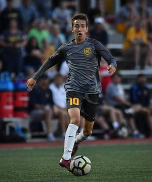 Moeller's Ben Hegge leads a late Crusaders charge against Mason Thursday, Aug. 23, 2018 at Gettler Stadium on the campus of the University of Cincinnati