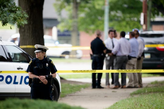 Cincinnati police investigate the scene of a confrontation at  2630 Victory Parkway that left a suspect dead and an officer wounded in Walnut Hills on Friday, Aug. 24, 2018.