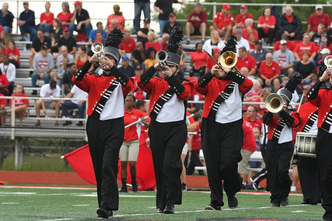 The Colerain marching band performs before the Crosstown Showdown game with La Salle Aug. 24.